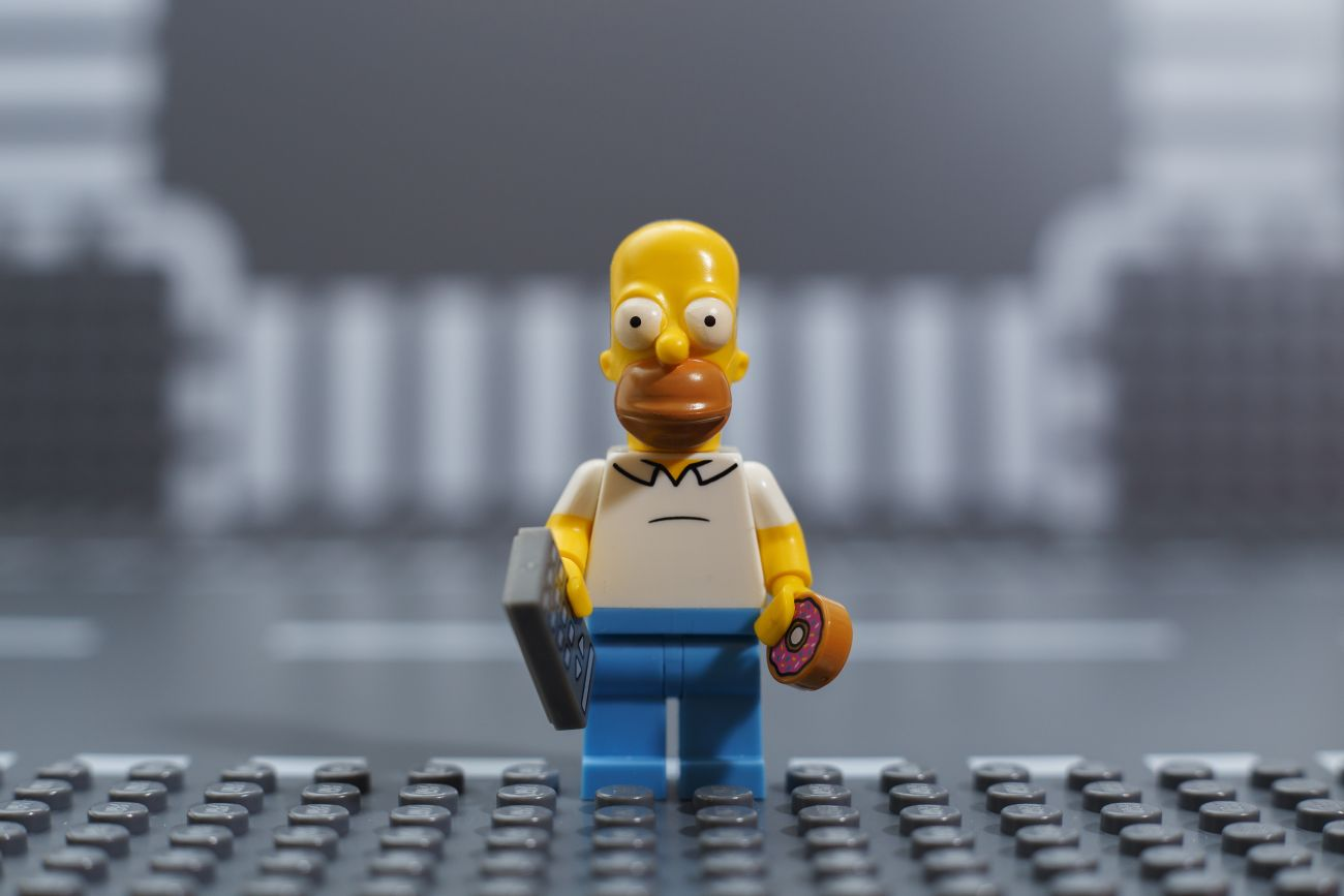 Homer Simpson with Donut and Calculator