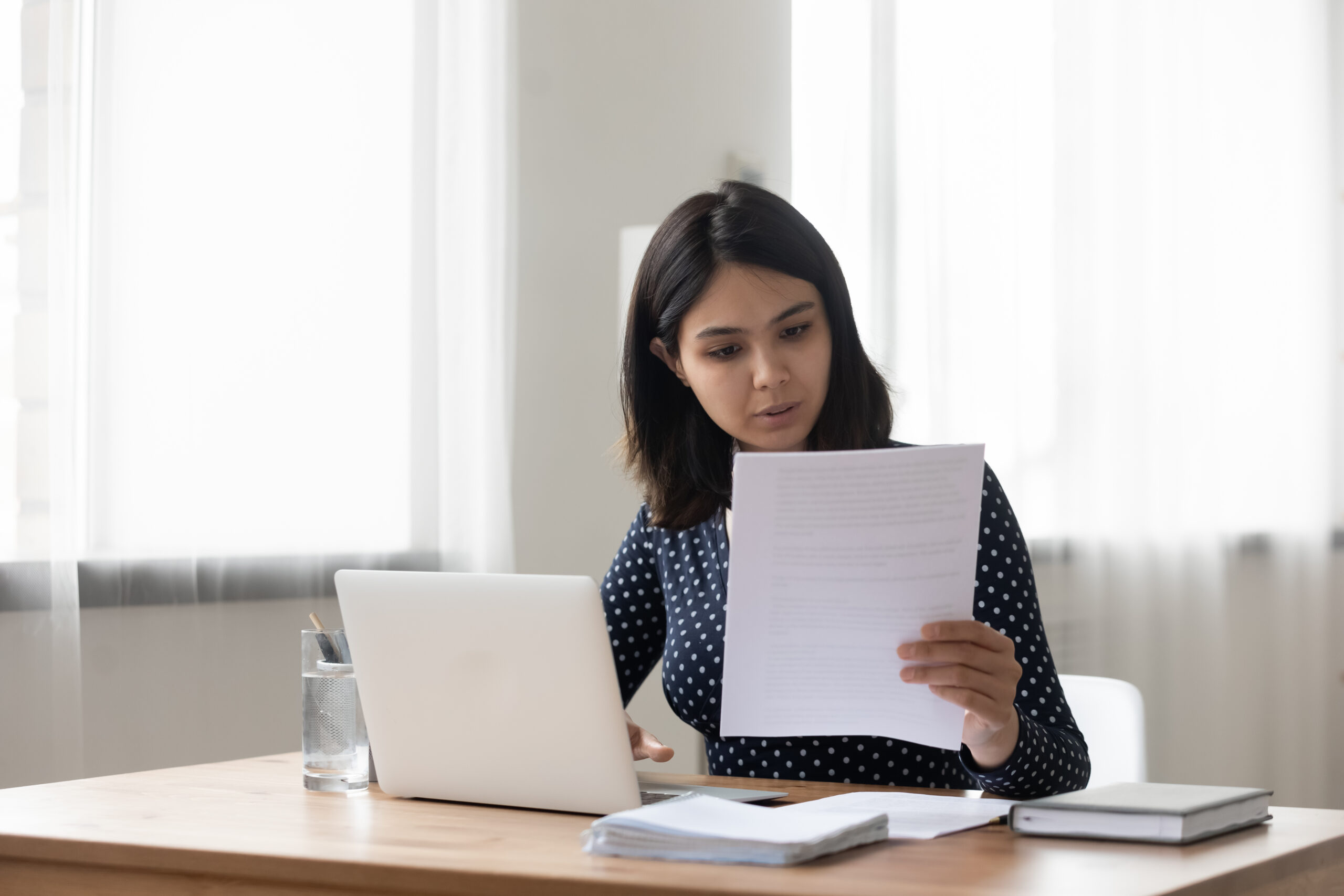 Young woman reading cover letter