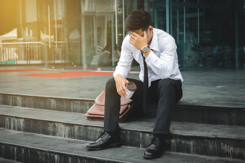 Unemployed Man Sad on Steps
