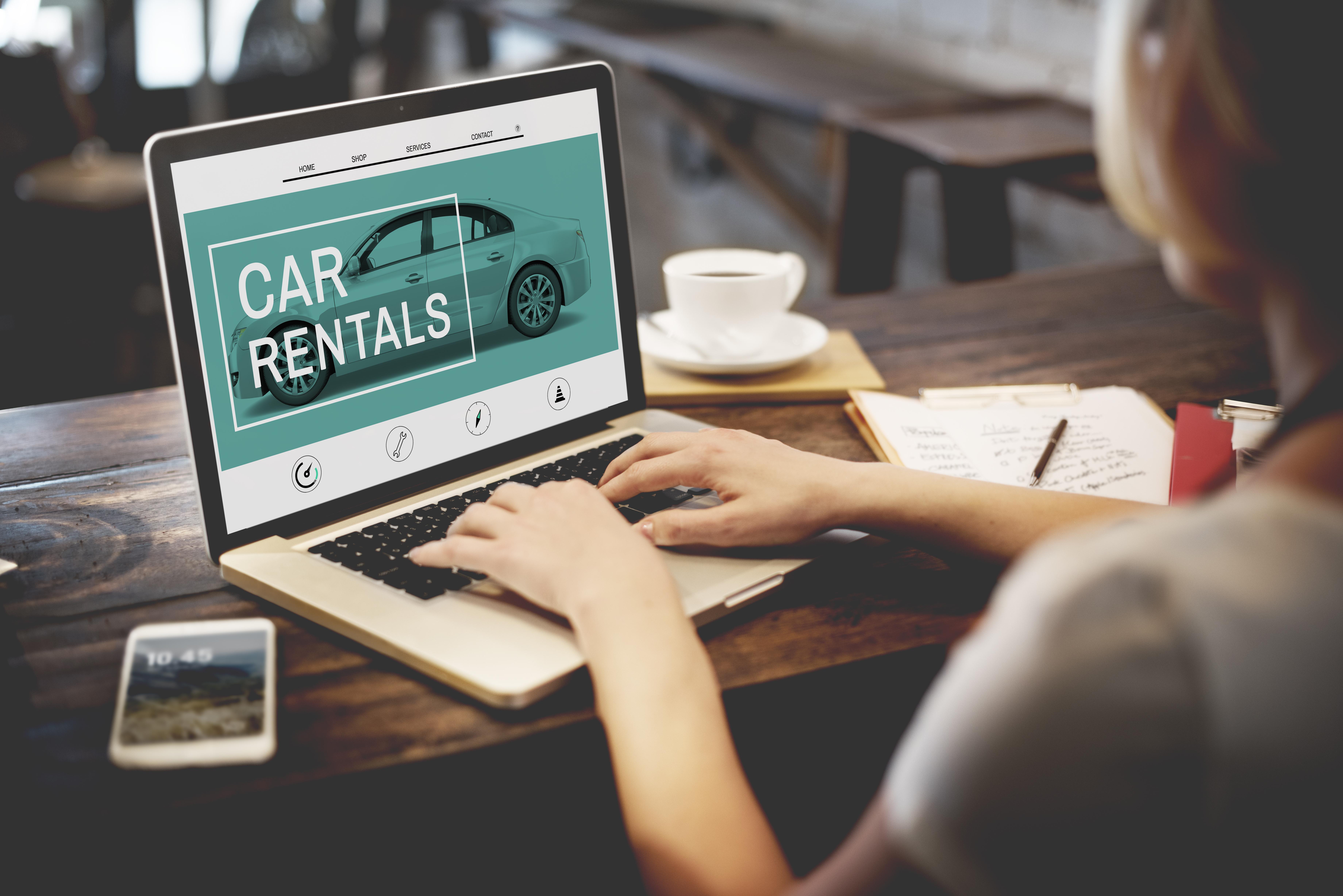 Woman Looking at Car Rental Website