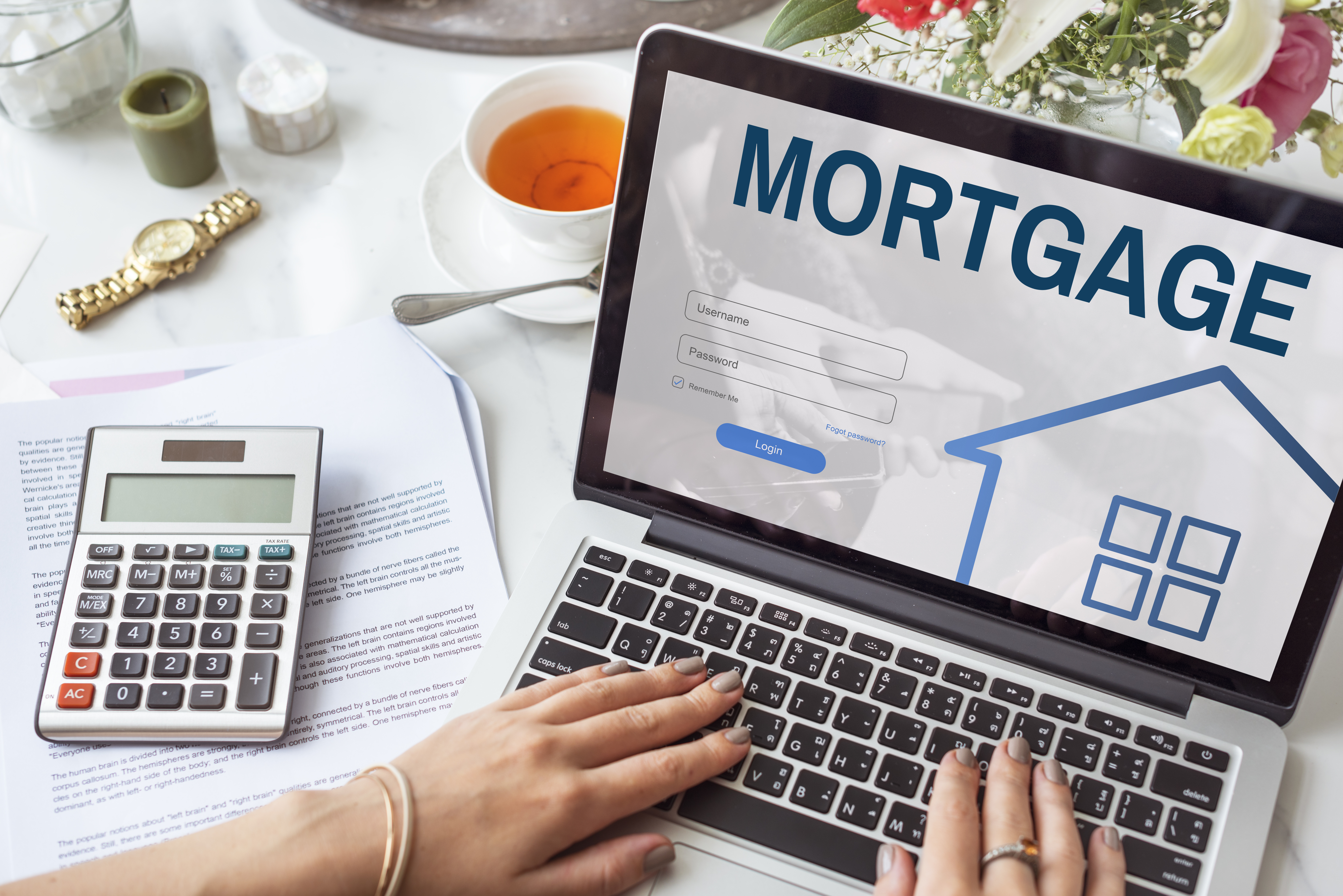 Woman Filling Out Online Mortgage Application