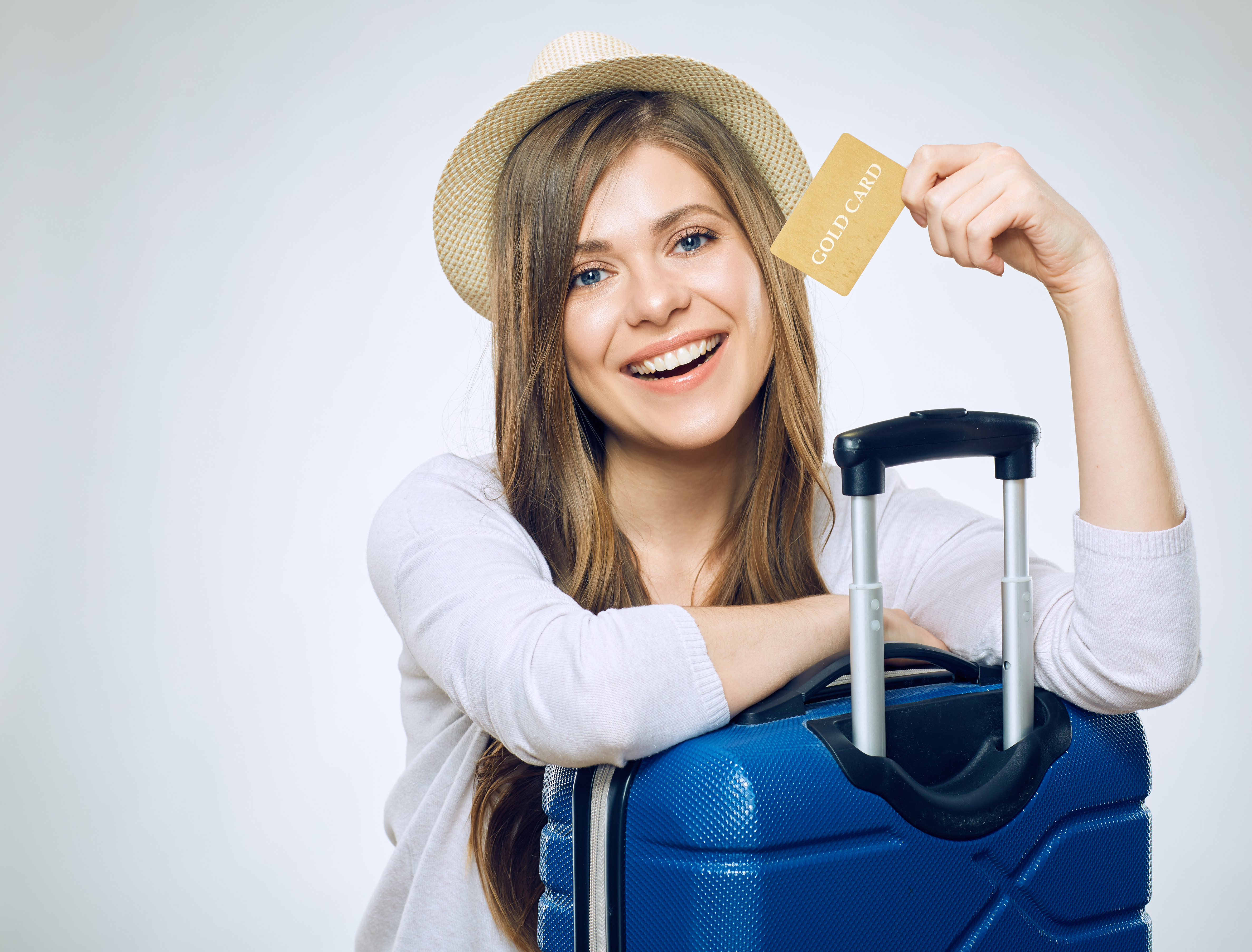Woman with Credit Card and Travel Luggage