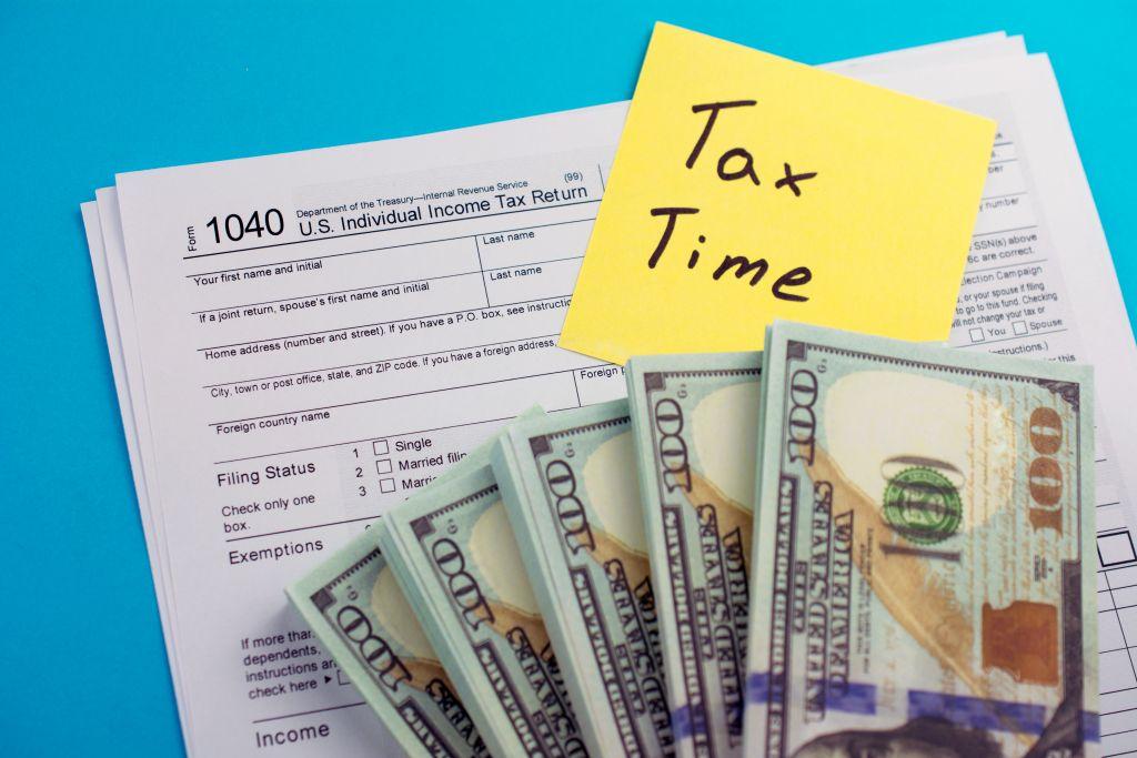 Tax Form 1040 Under Cash Stacks