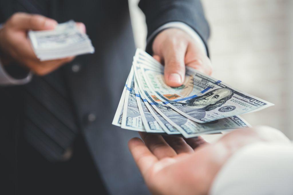 Man Lending Money to Friend