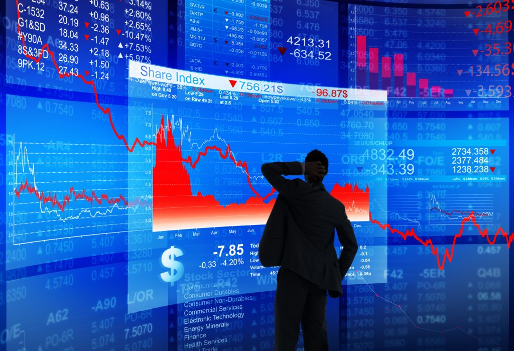 Man Watching Blue and Red Stock Chart