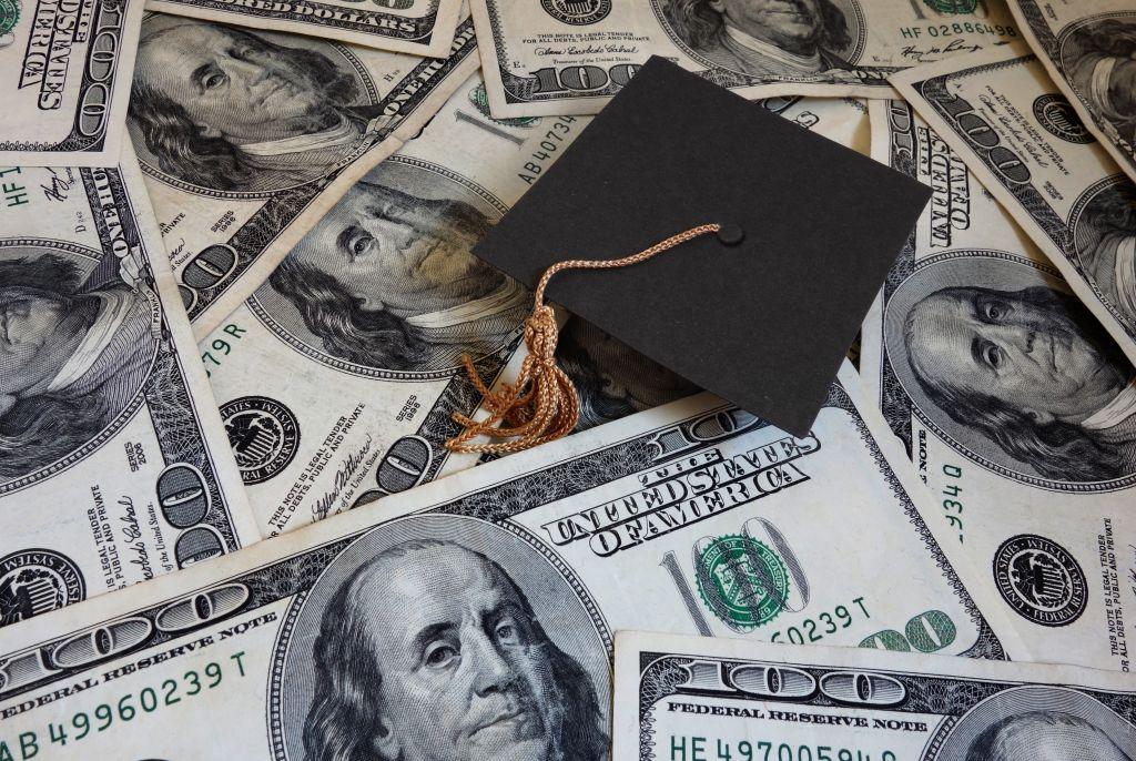 Cash with Student Grad Cap