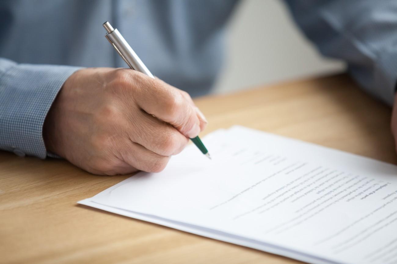Elderly Hand Signing Documents