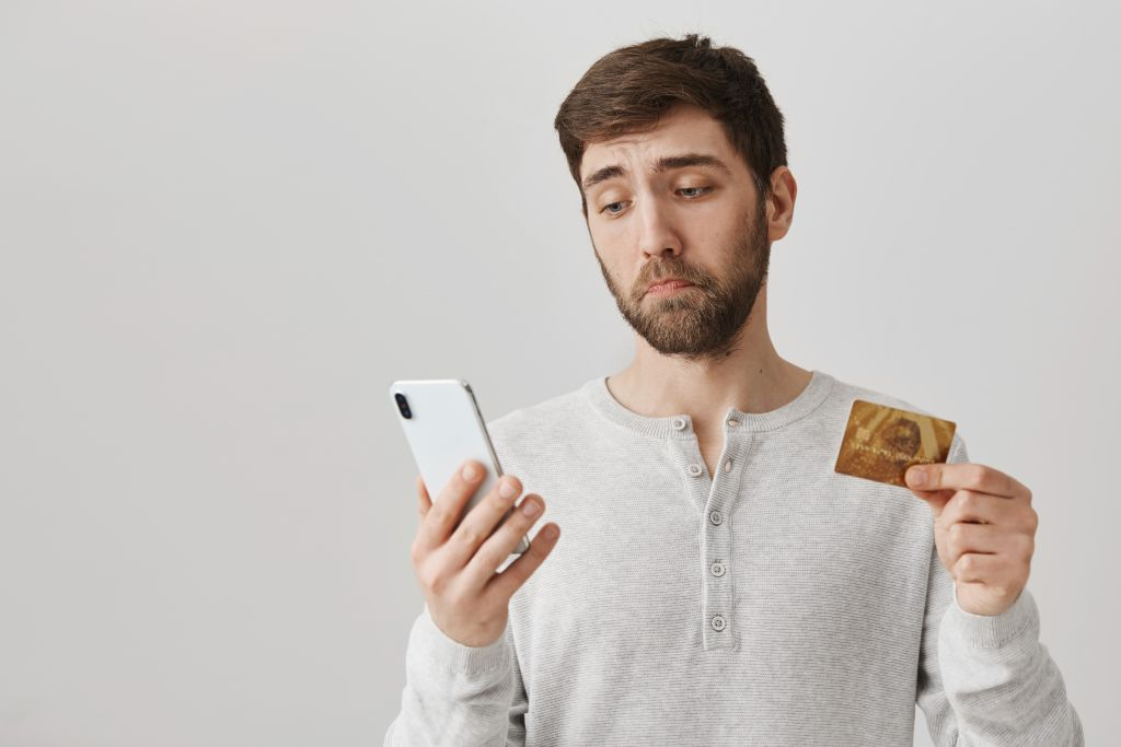 Man with Credit Card and Phone