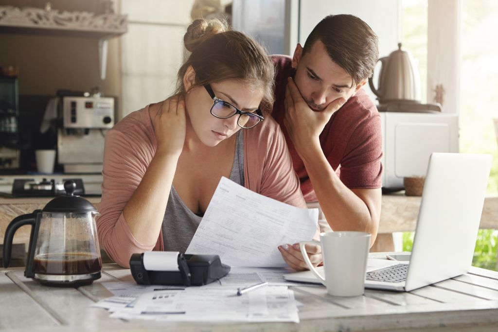 Couple Looking Over Taxes in Kitchen