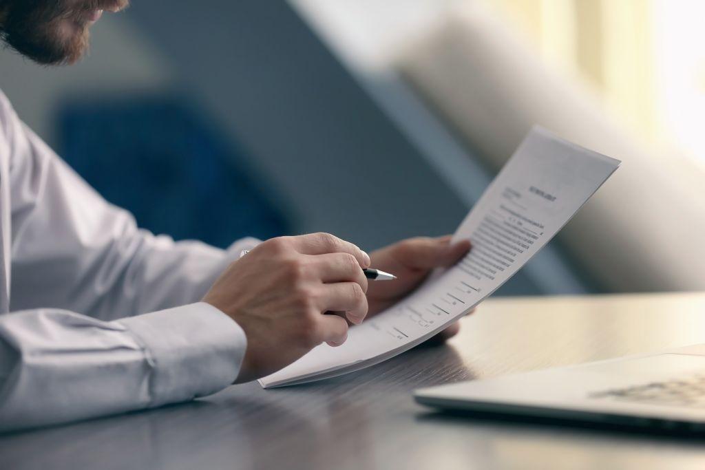 Man Studying Document