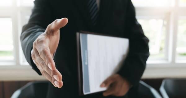 Business Man Offering Hand Shake