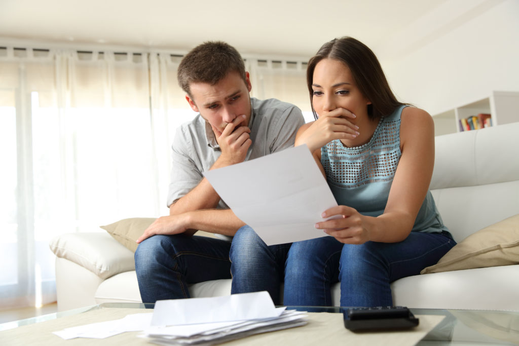 Couple Studying Bankruptcy Documents
