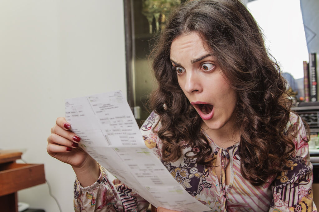 Woman Shocked by Large Bill