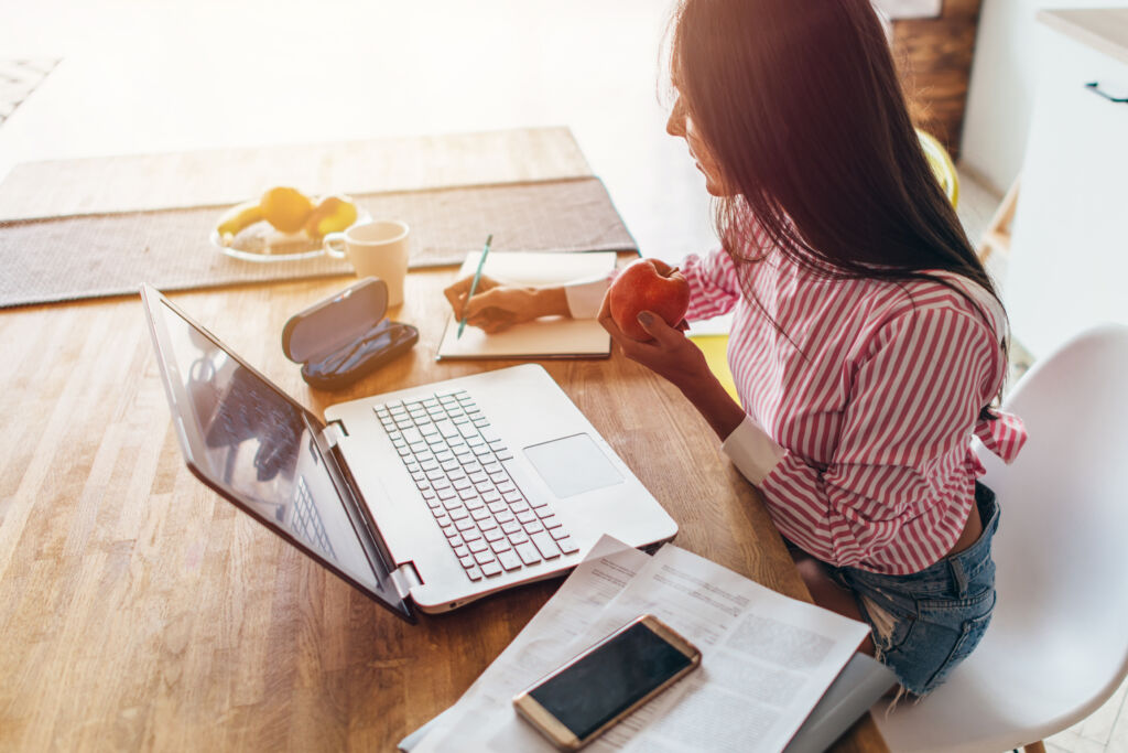 Woman Working on Budget at Desk