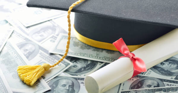 Student Graduation Cap on Top of Money