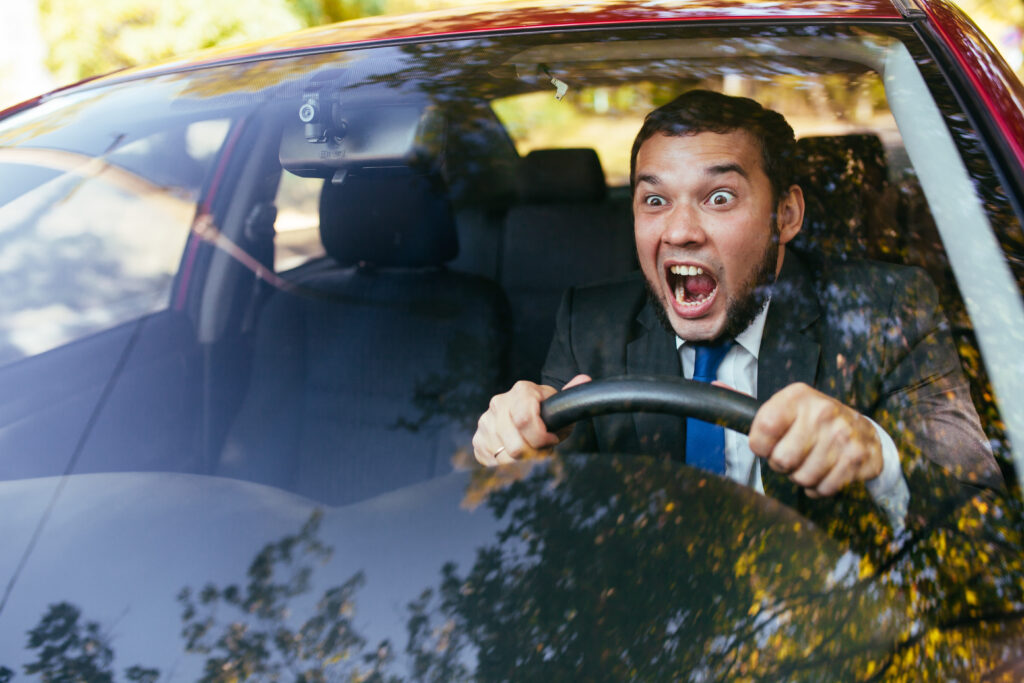 Guy Yelling Driving Car