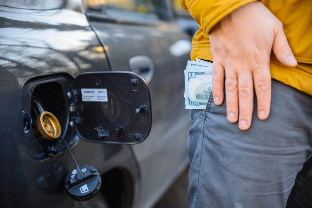 Cash in Pocket by Car Gas Cap