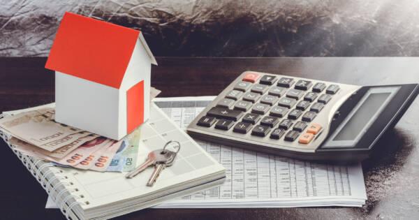 House, Calculator, & Cash on Desktop