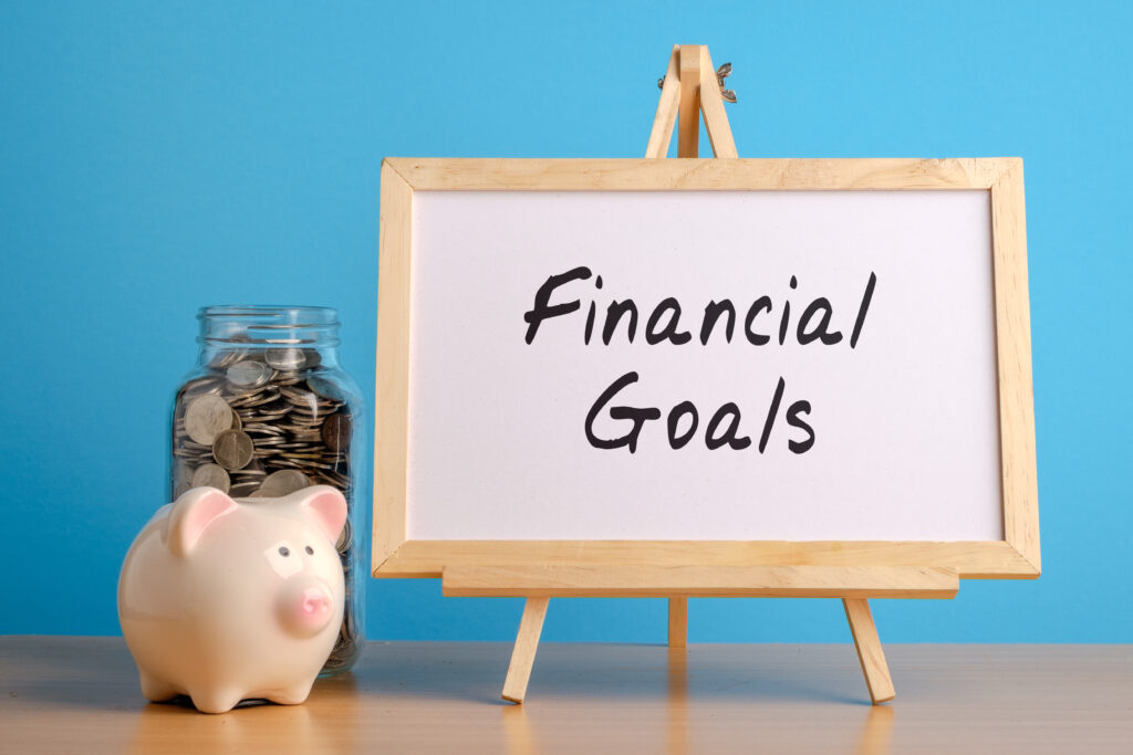 Financial Goals Whiteboard with Coin Jar and Piggy Bank