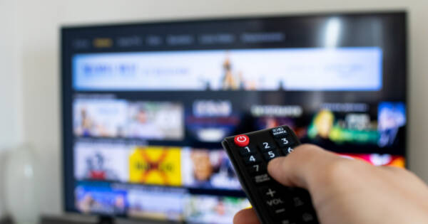 Person Browsing TV App with Remote