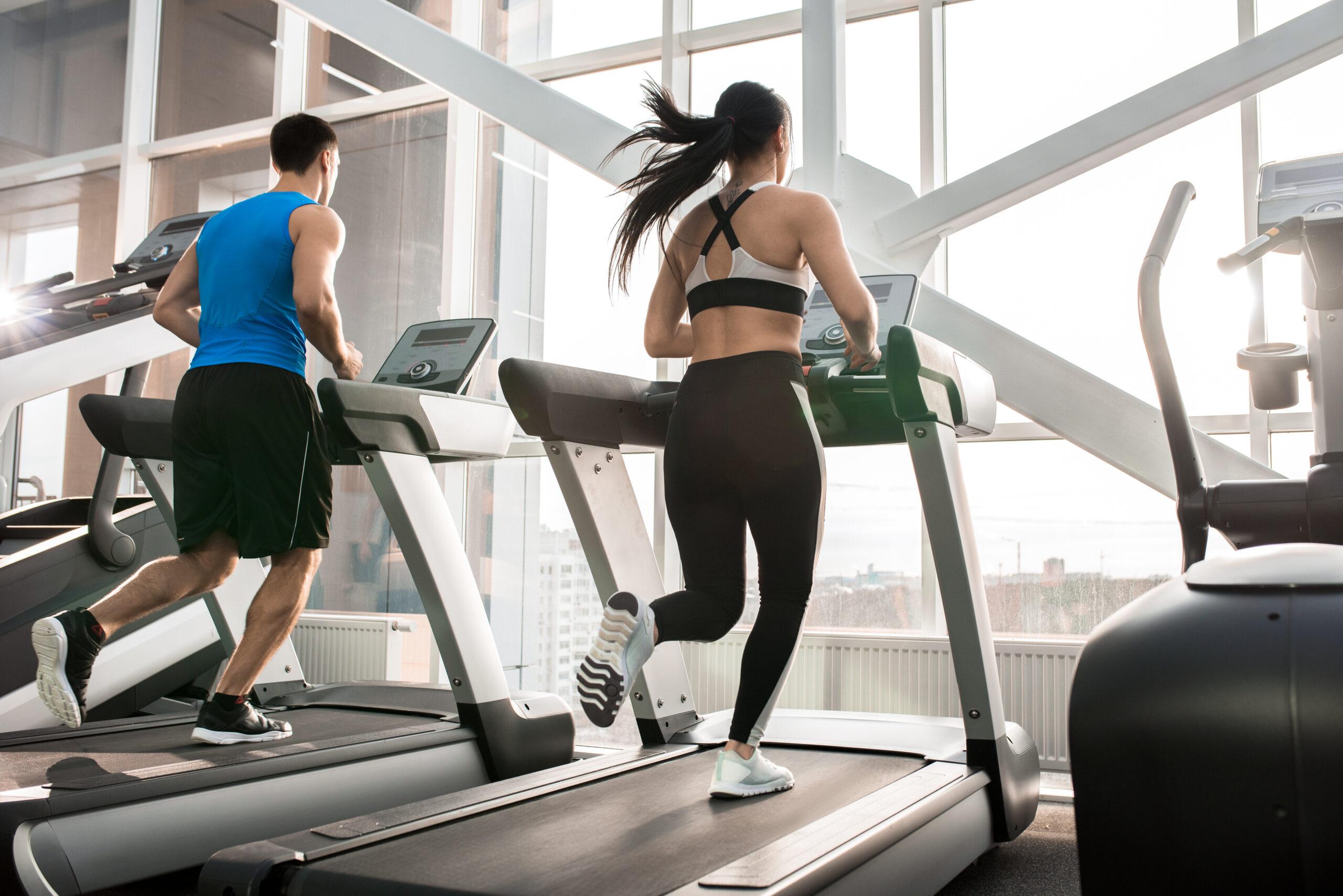 Gym Members Running on Treadmill