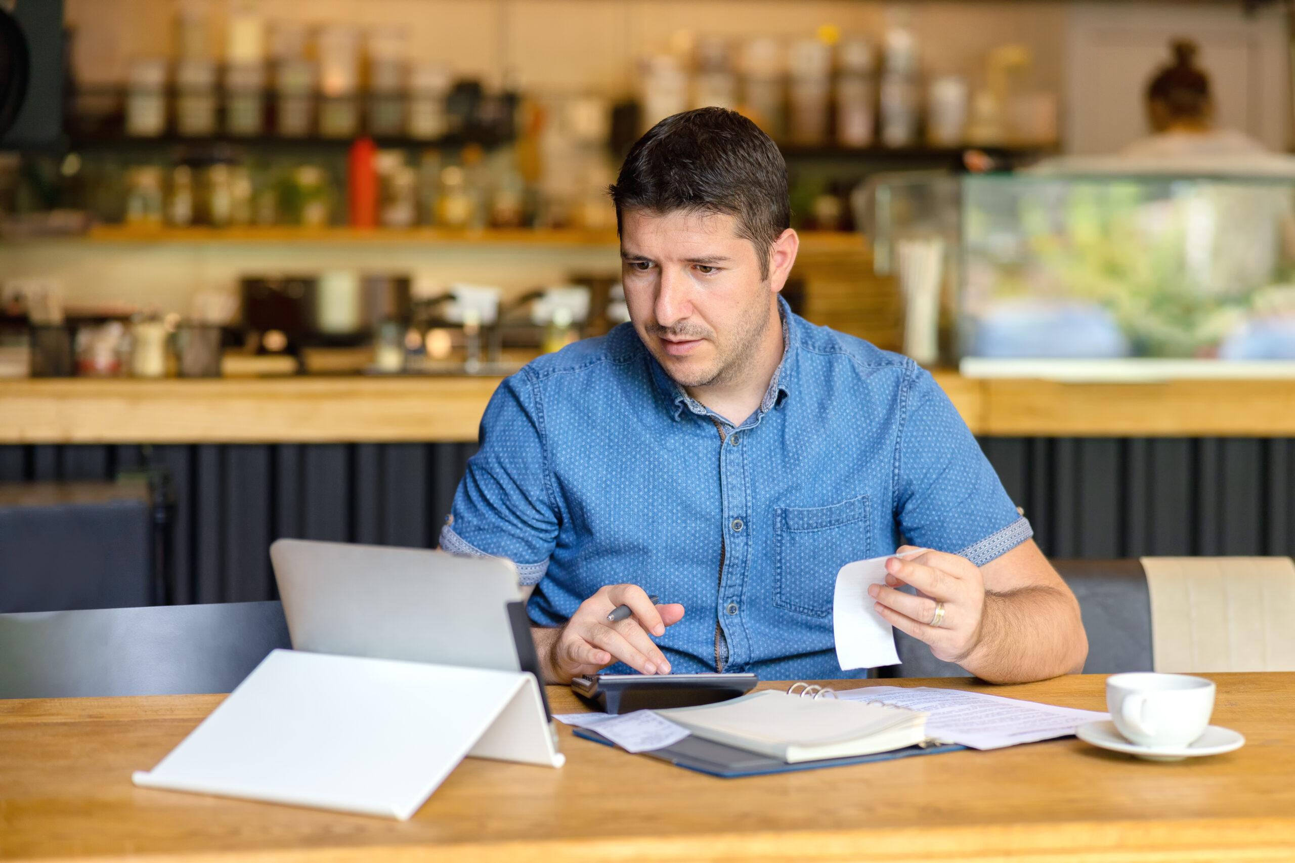 Restaurant owner calculating backup withholding