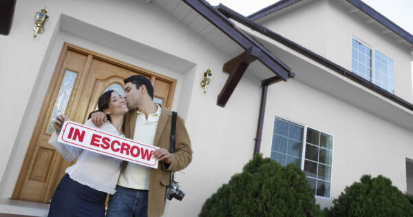 Couple buying home in escrow