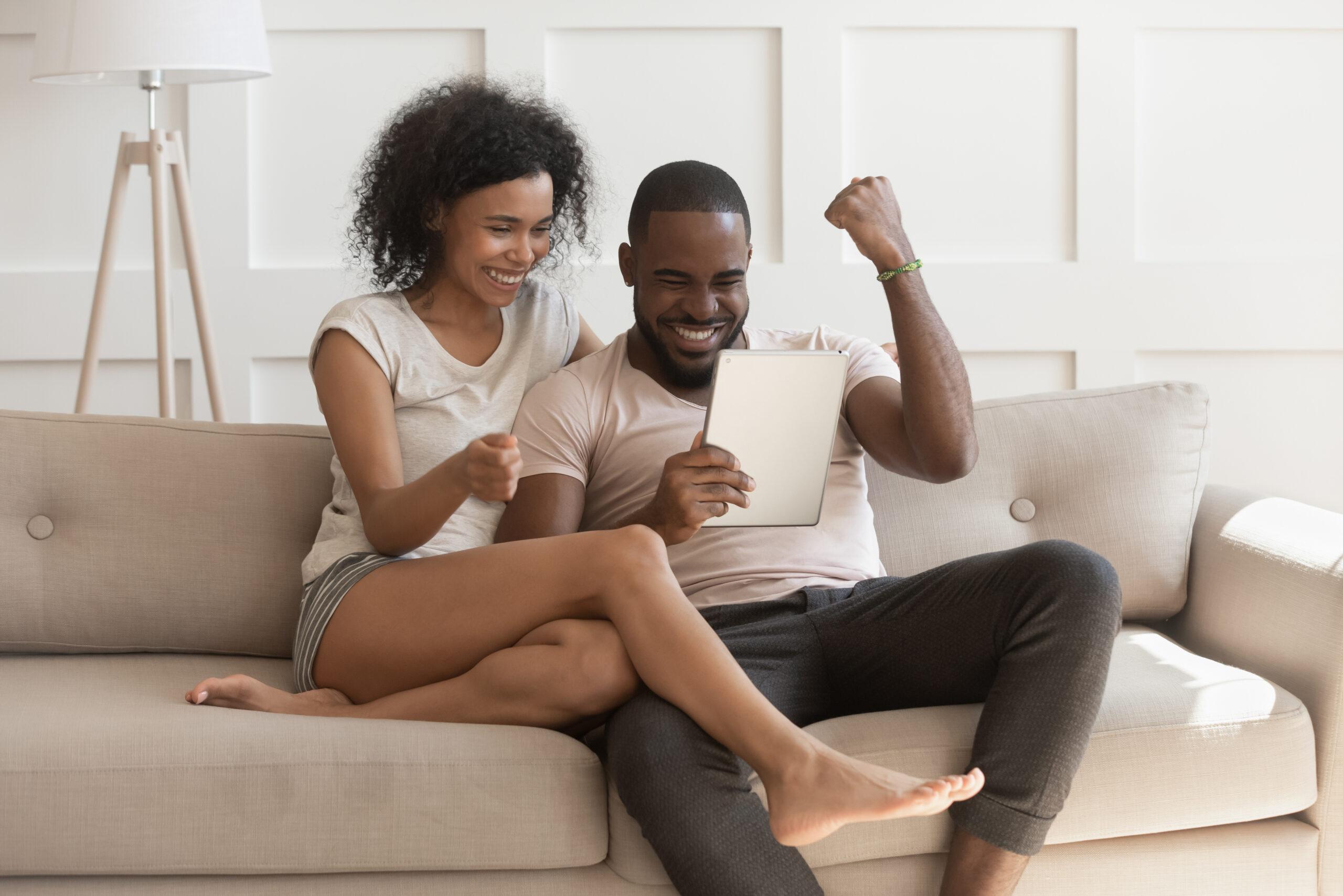 Happy couple winning a house bidding war