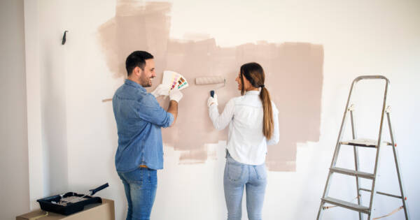 young couple redecorating a house