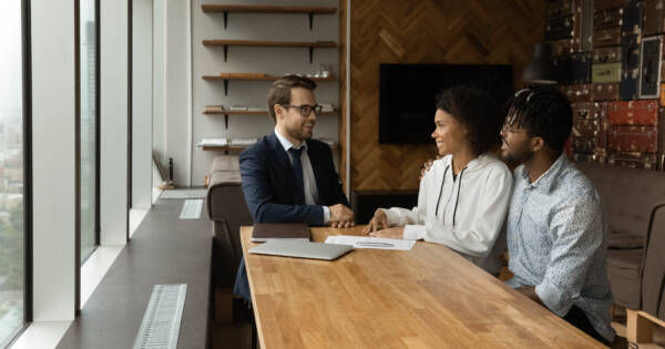 Young couple talking to insurance agent