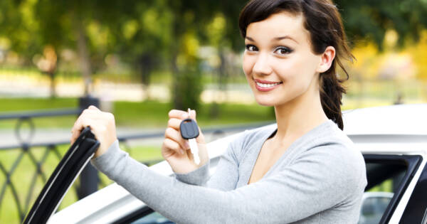 Young woman with a new car
