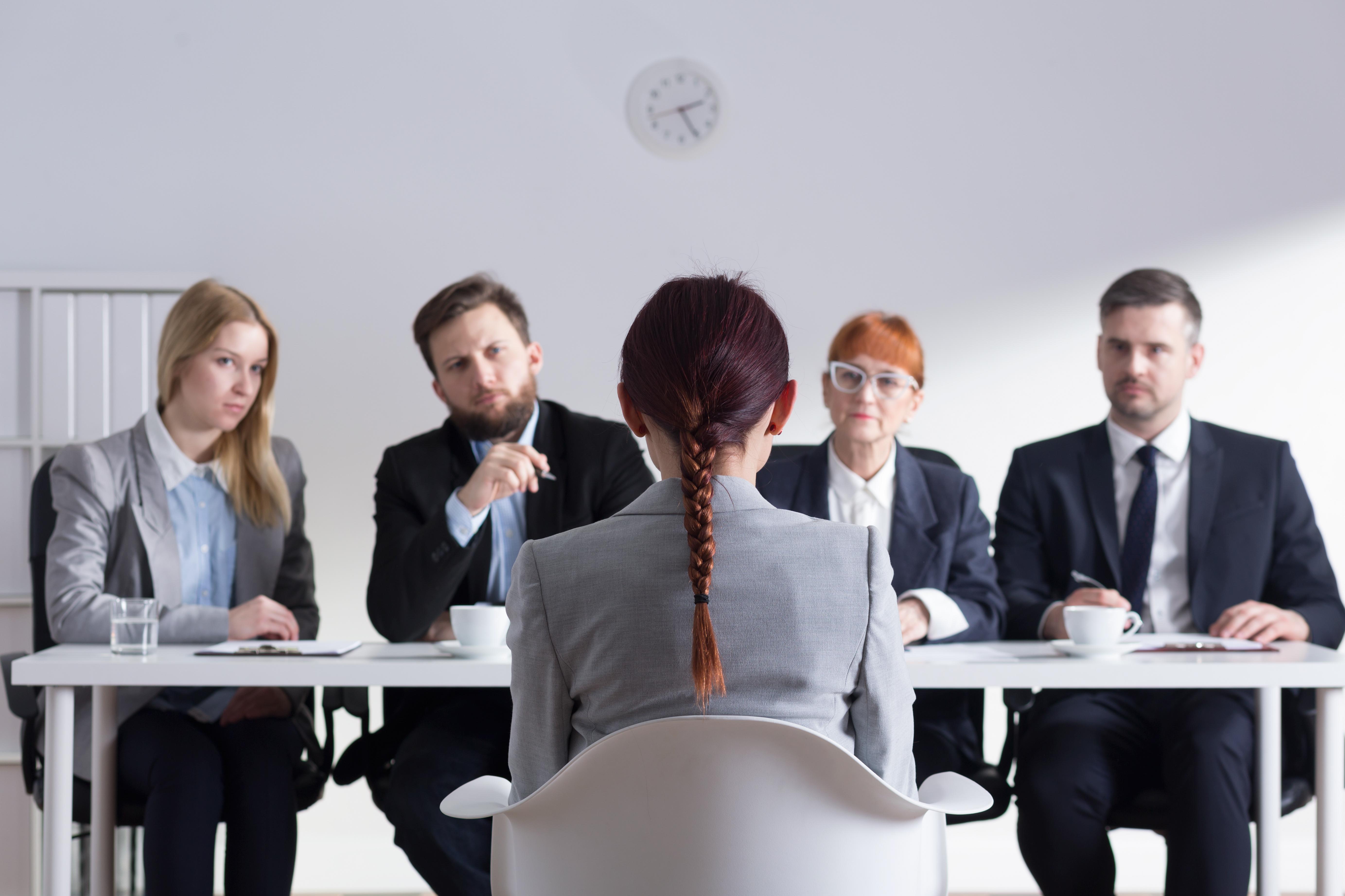 Woman facing hiring committee in job interview