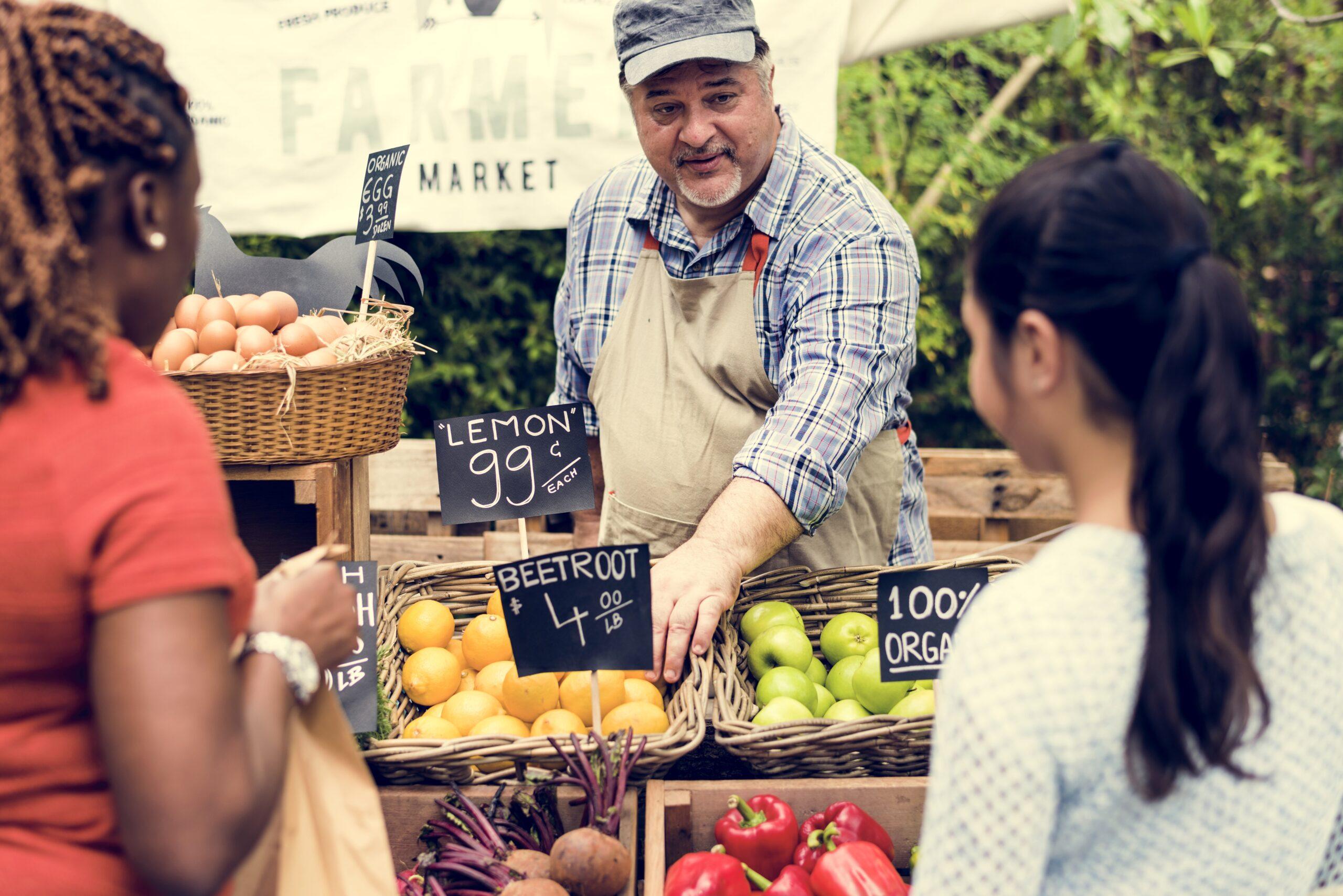 Farmer selling fruit at farmers' market