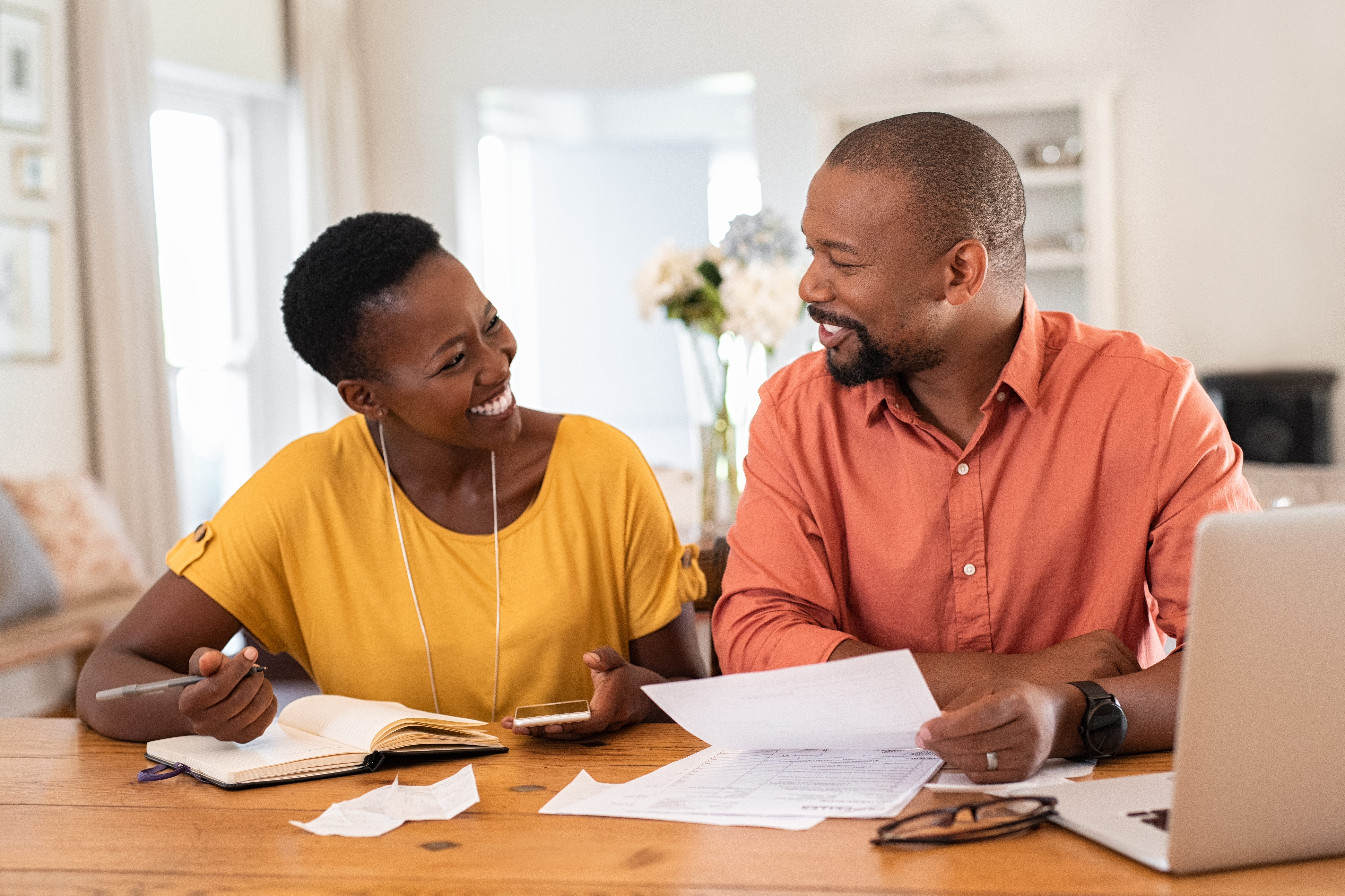 young couple happy about eliminating their debt
