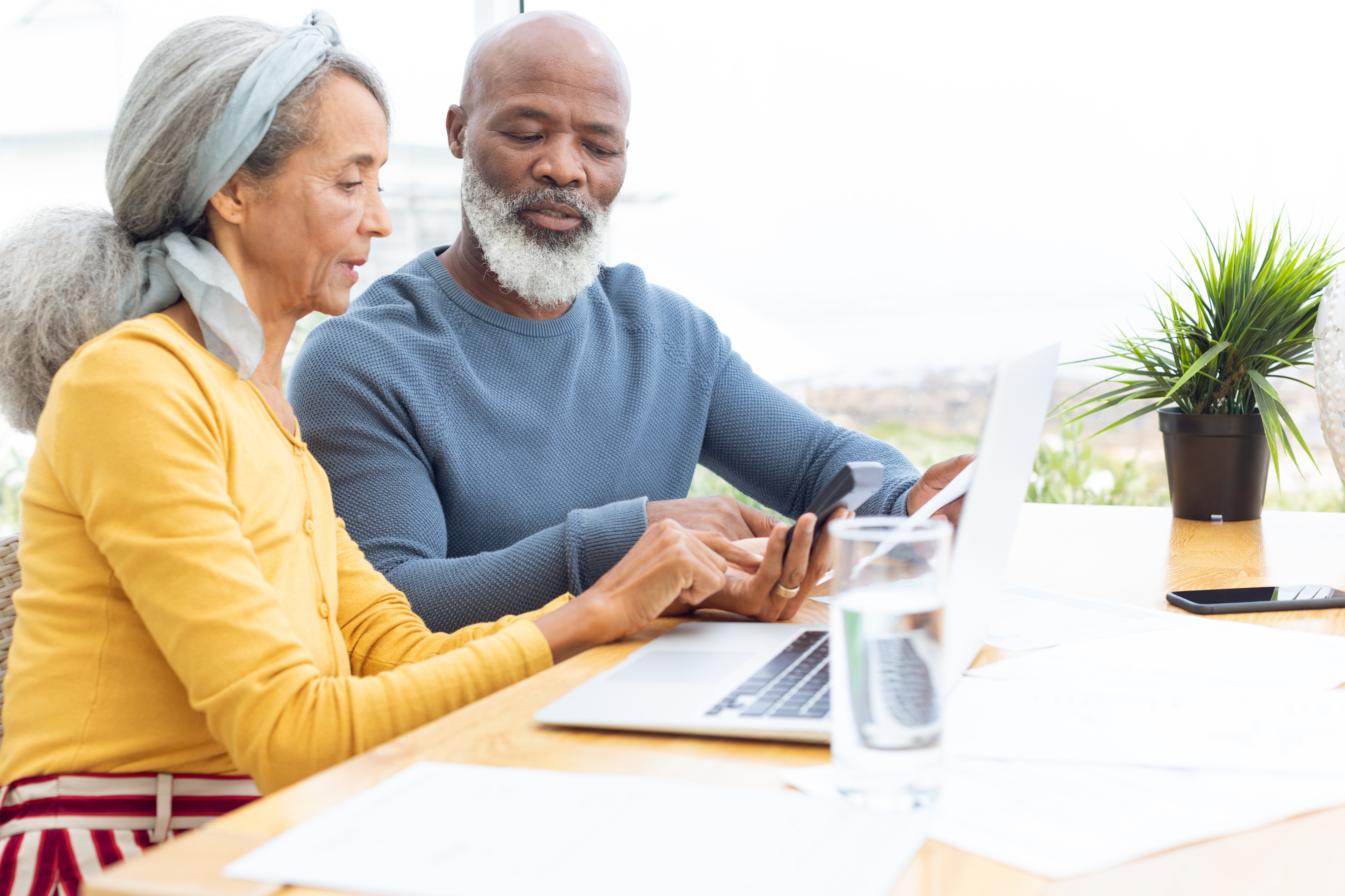 Retired couple checking their investments