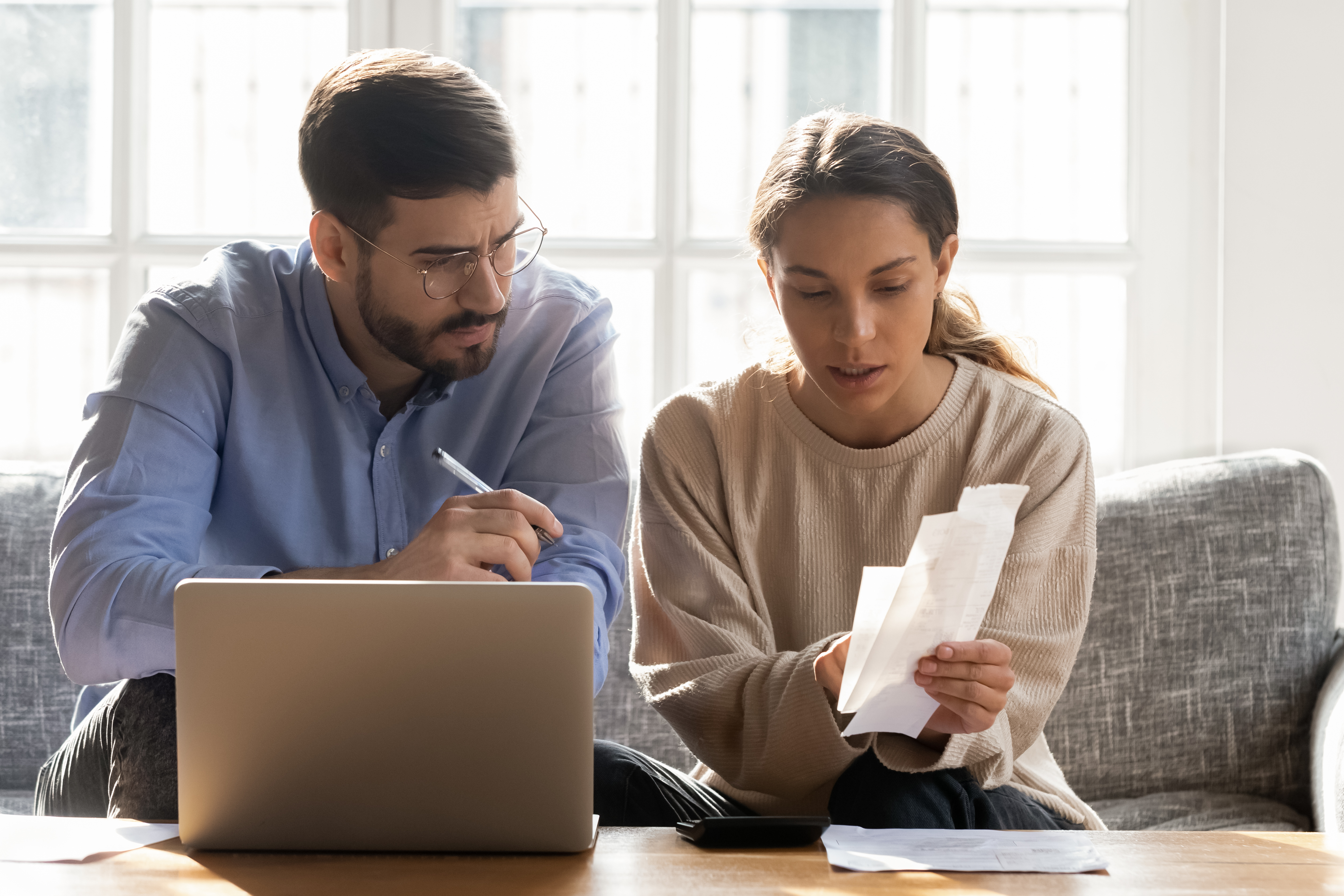 young couple balancing their budget
