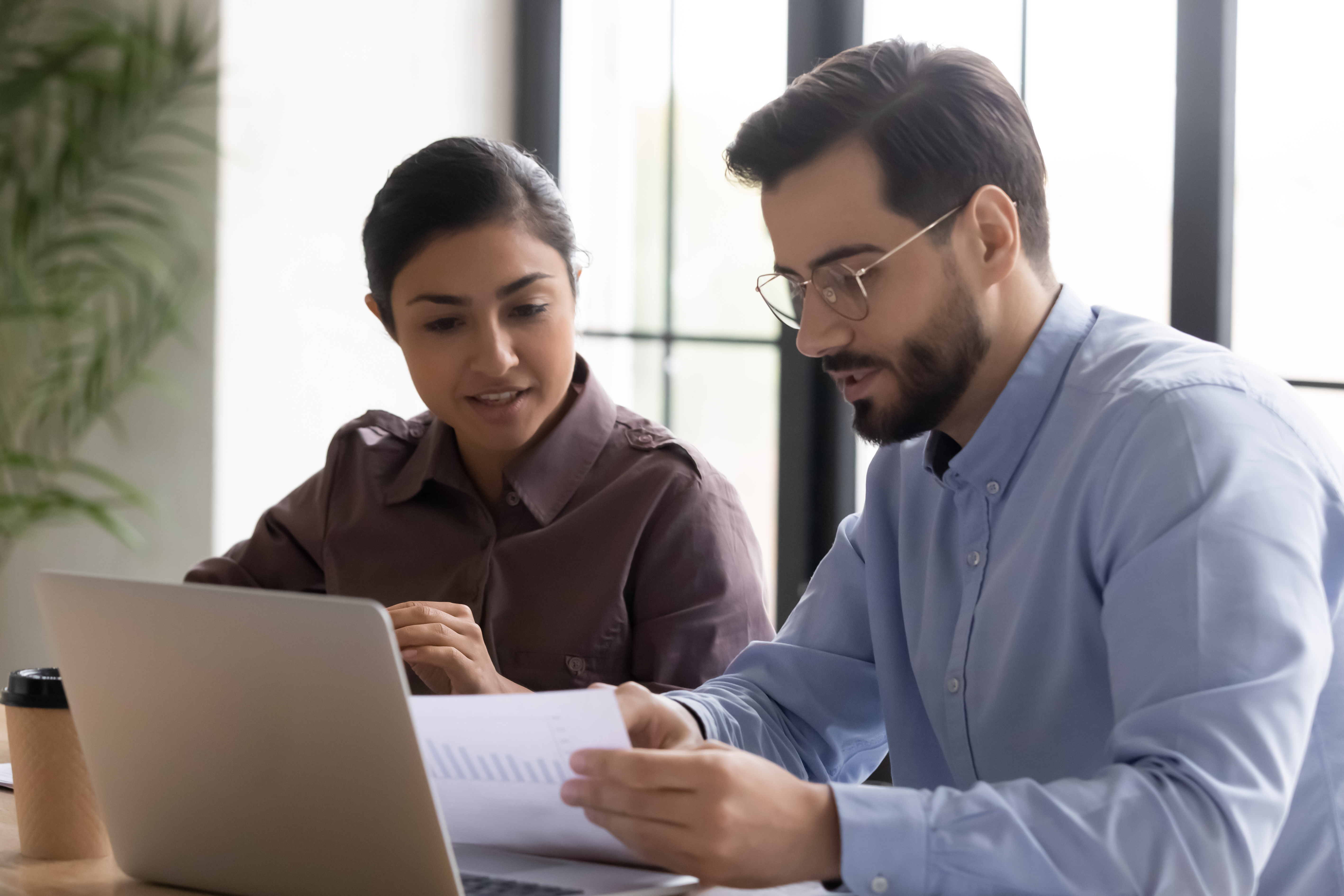 Employees looking over financial records