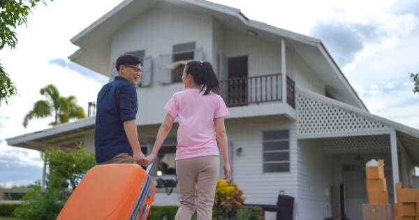 Young couple moving into their first house