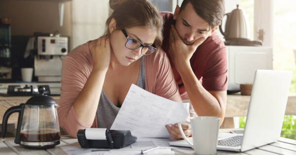 Young couple worrying about bills and budgeting
