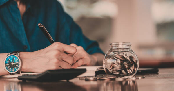 Business man saving money in sinking fund