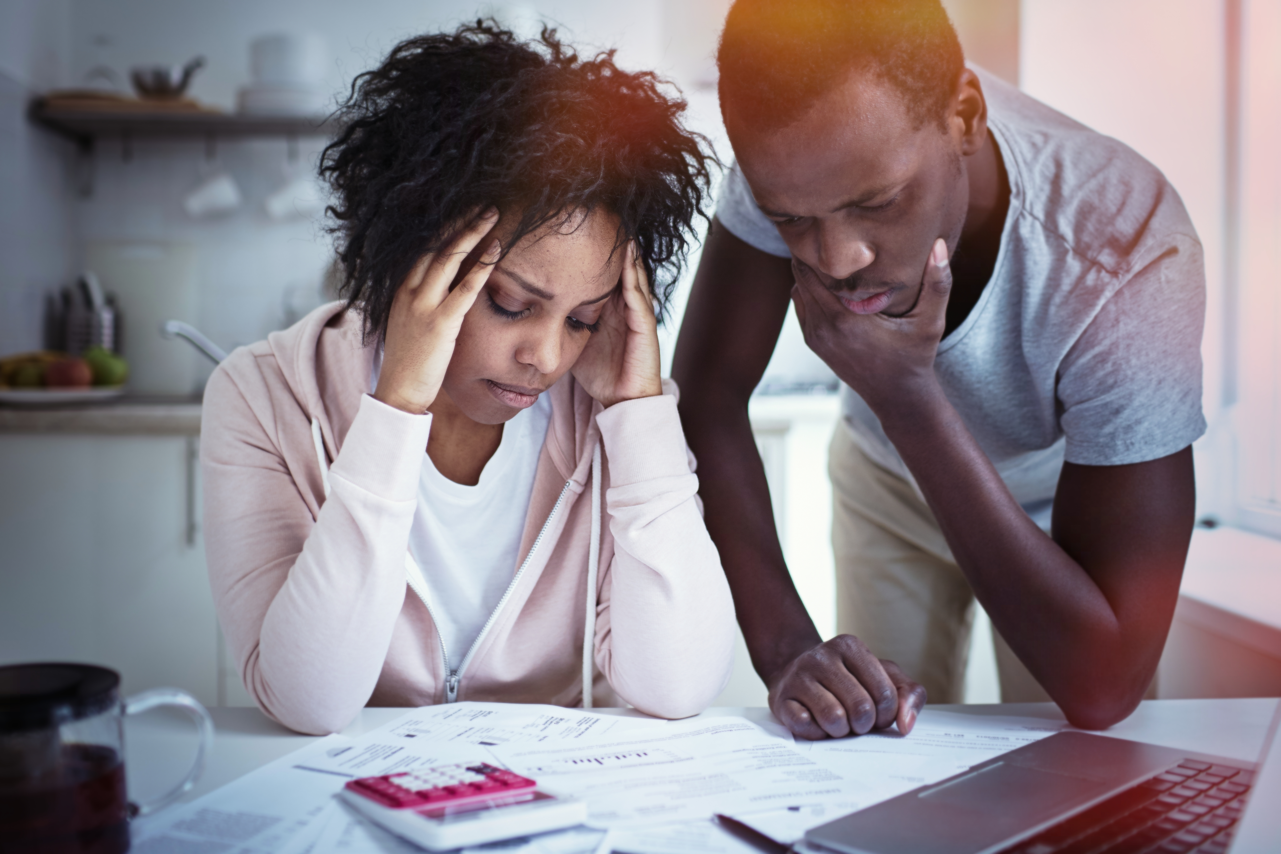young couple stressed about money