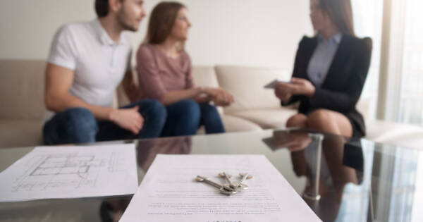 Young couple considering loan paperwork