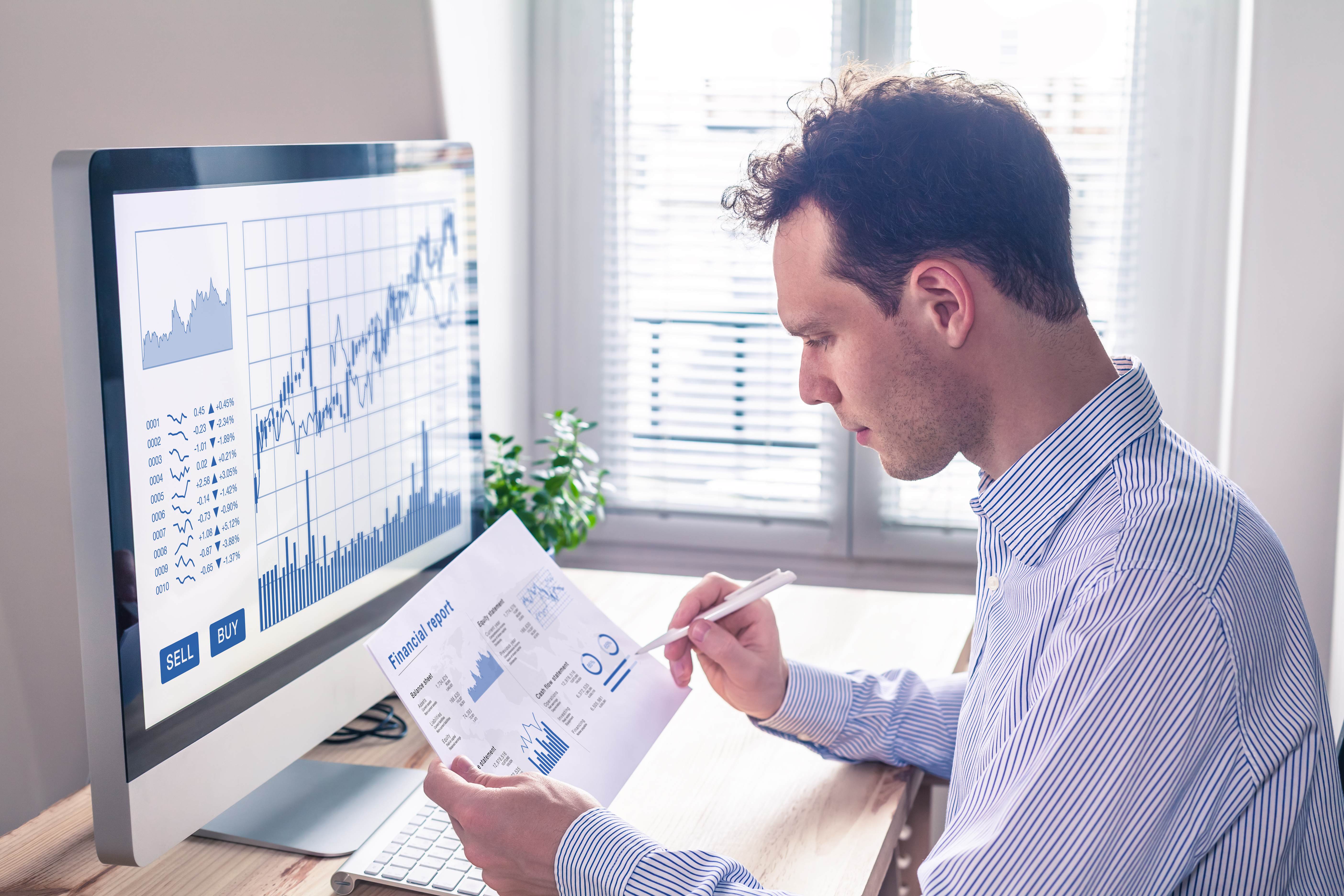 young man checking his dividend investments