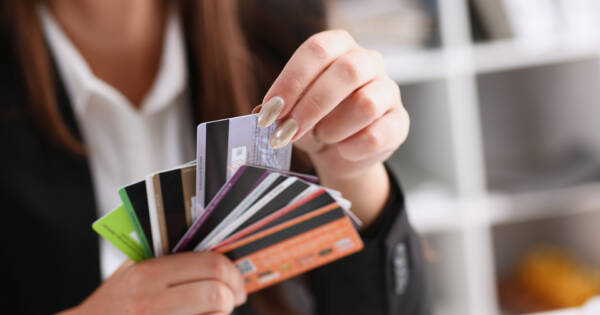 Young woman selecting a credit card