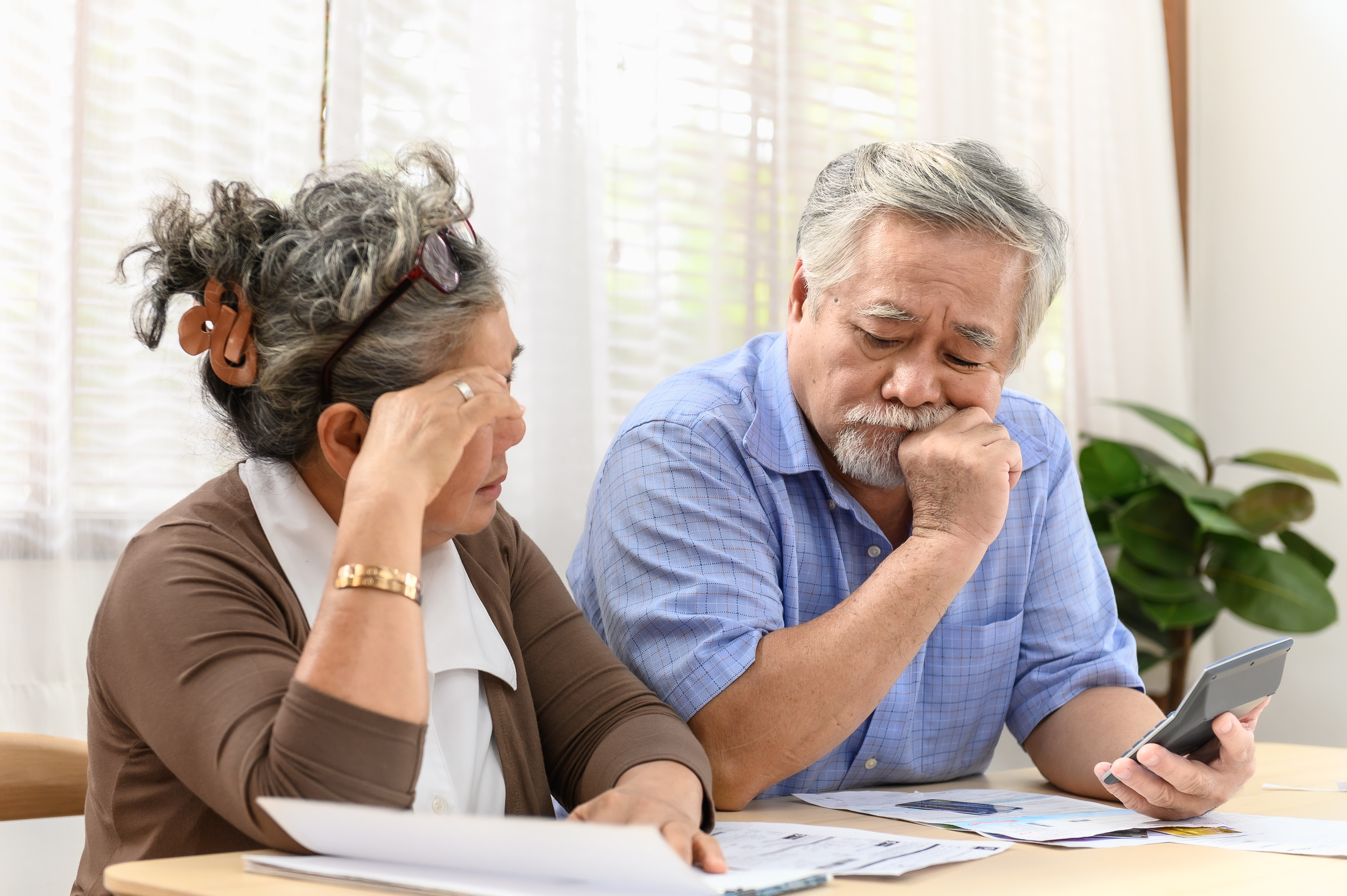 Older Asian couple worried about money