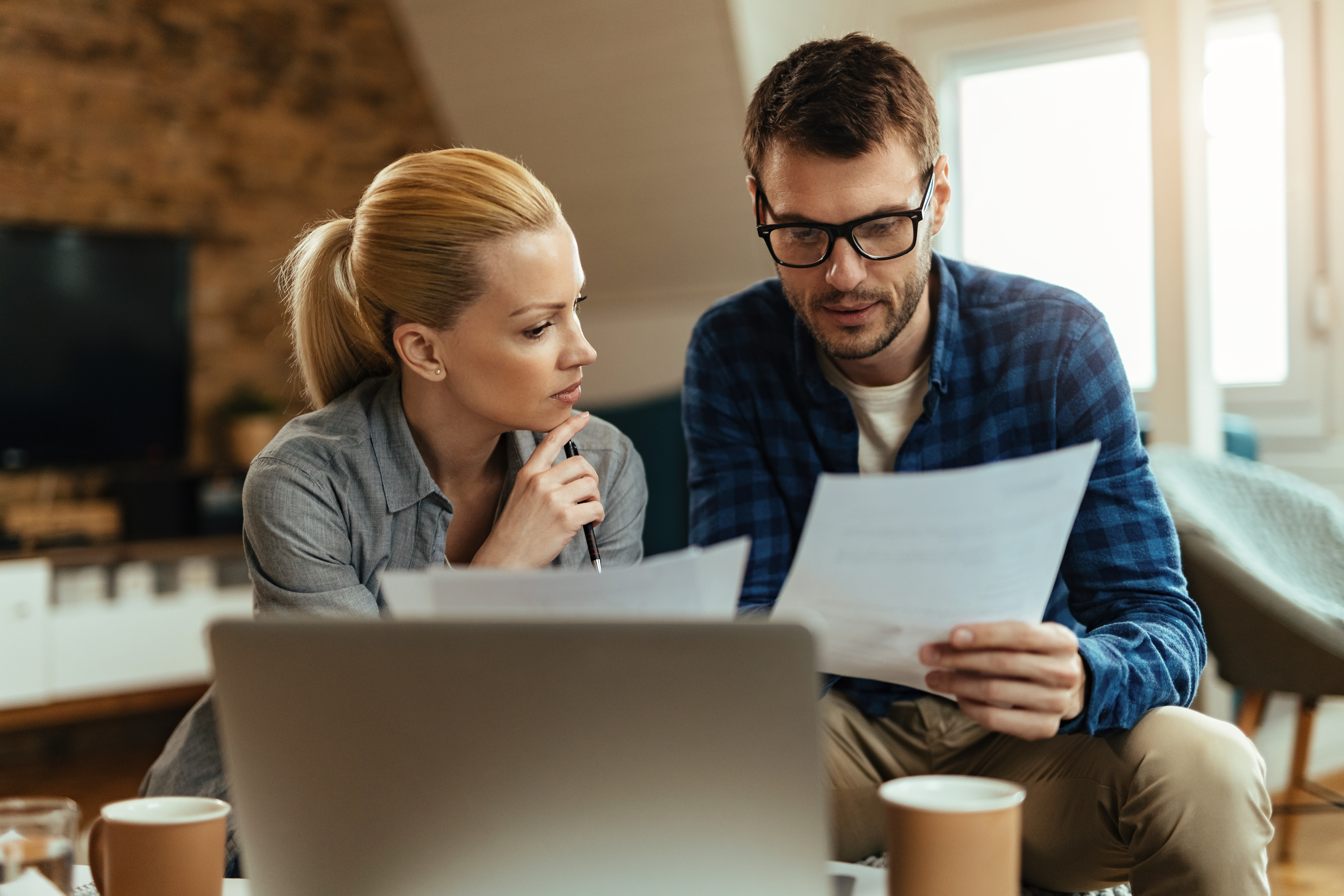 Young couple simplifying their finances
