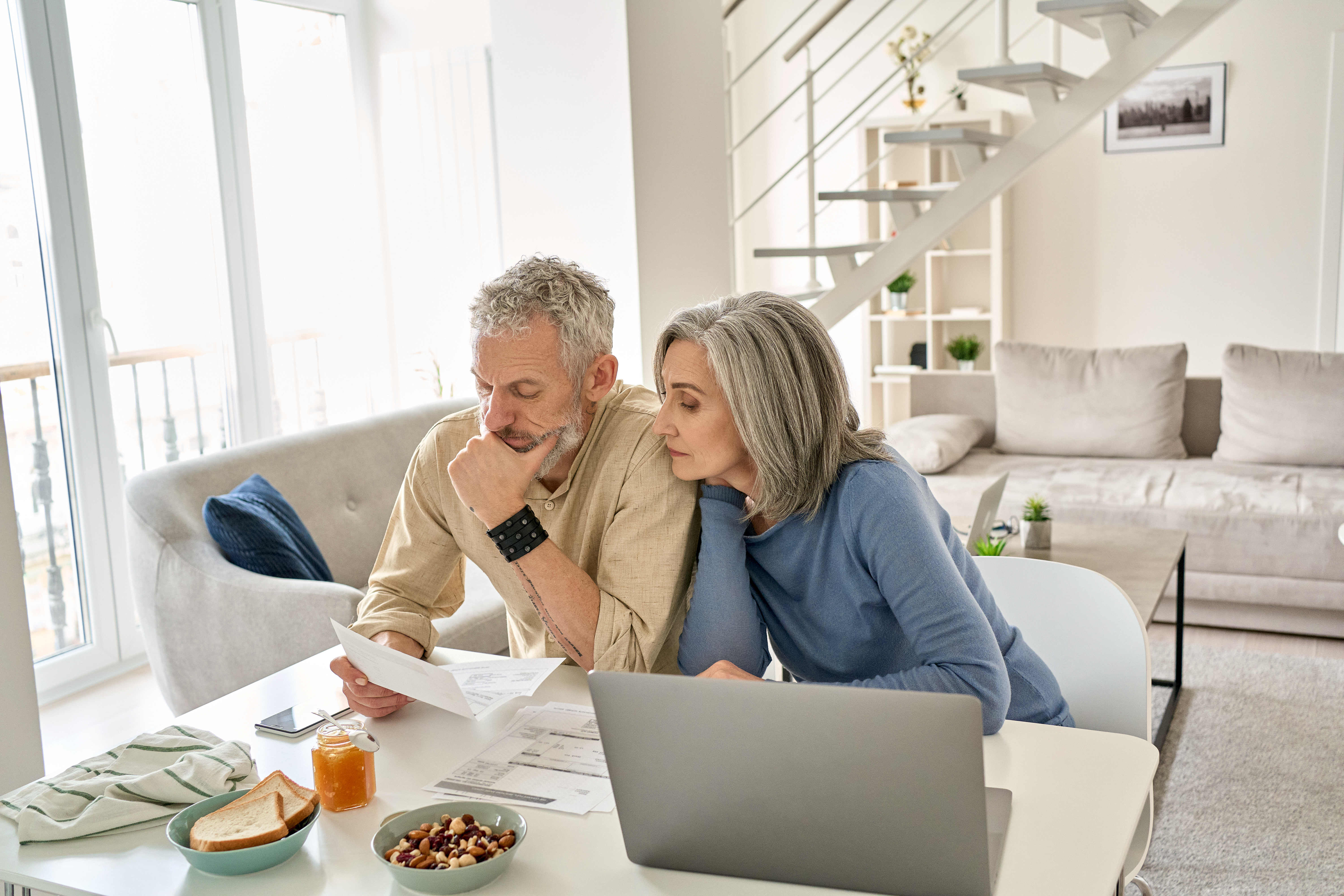 Middle-aged couple looking at retirement savings