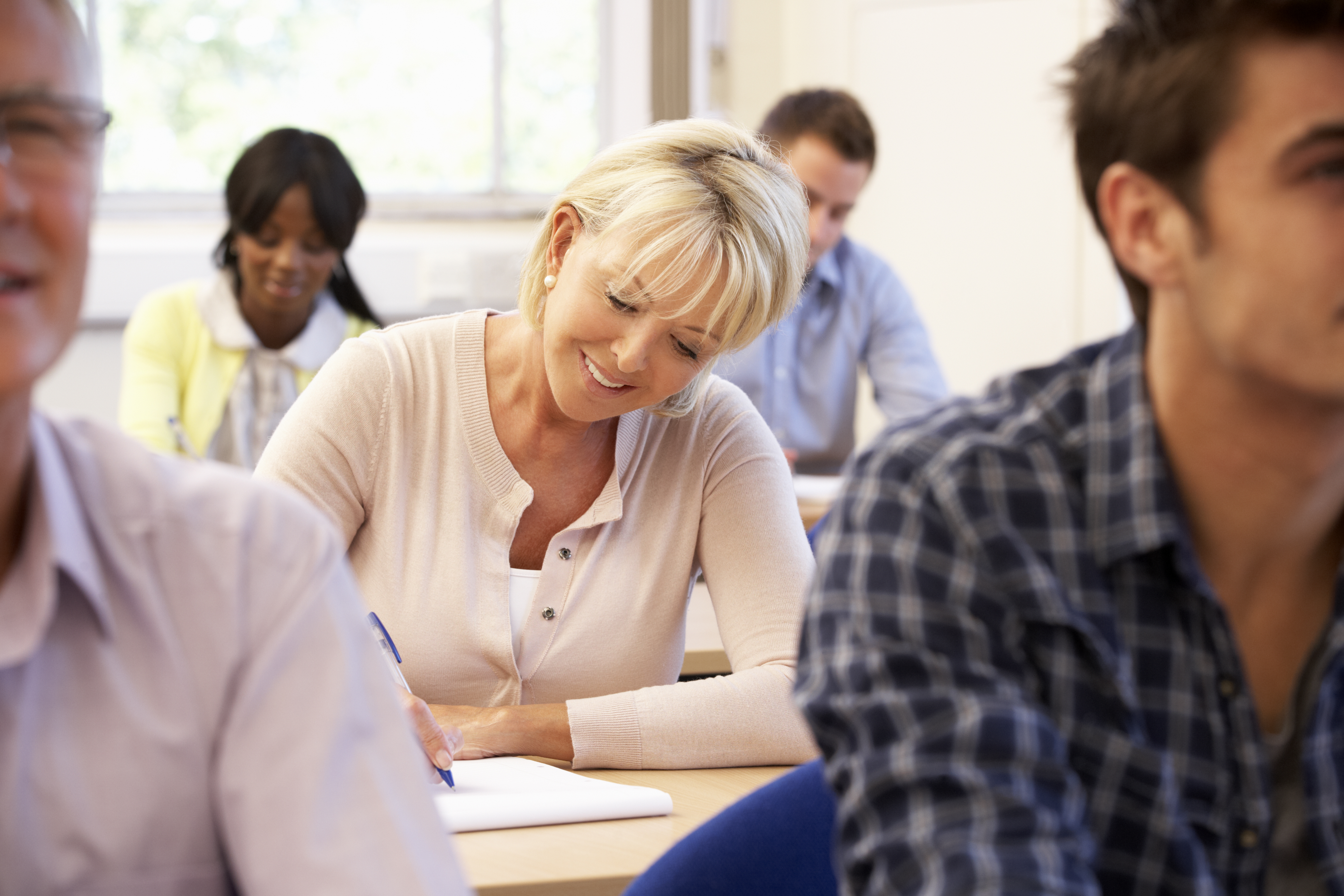 Middle-aged woman attending college class