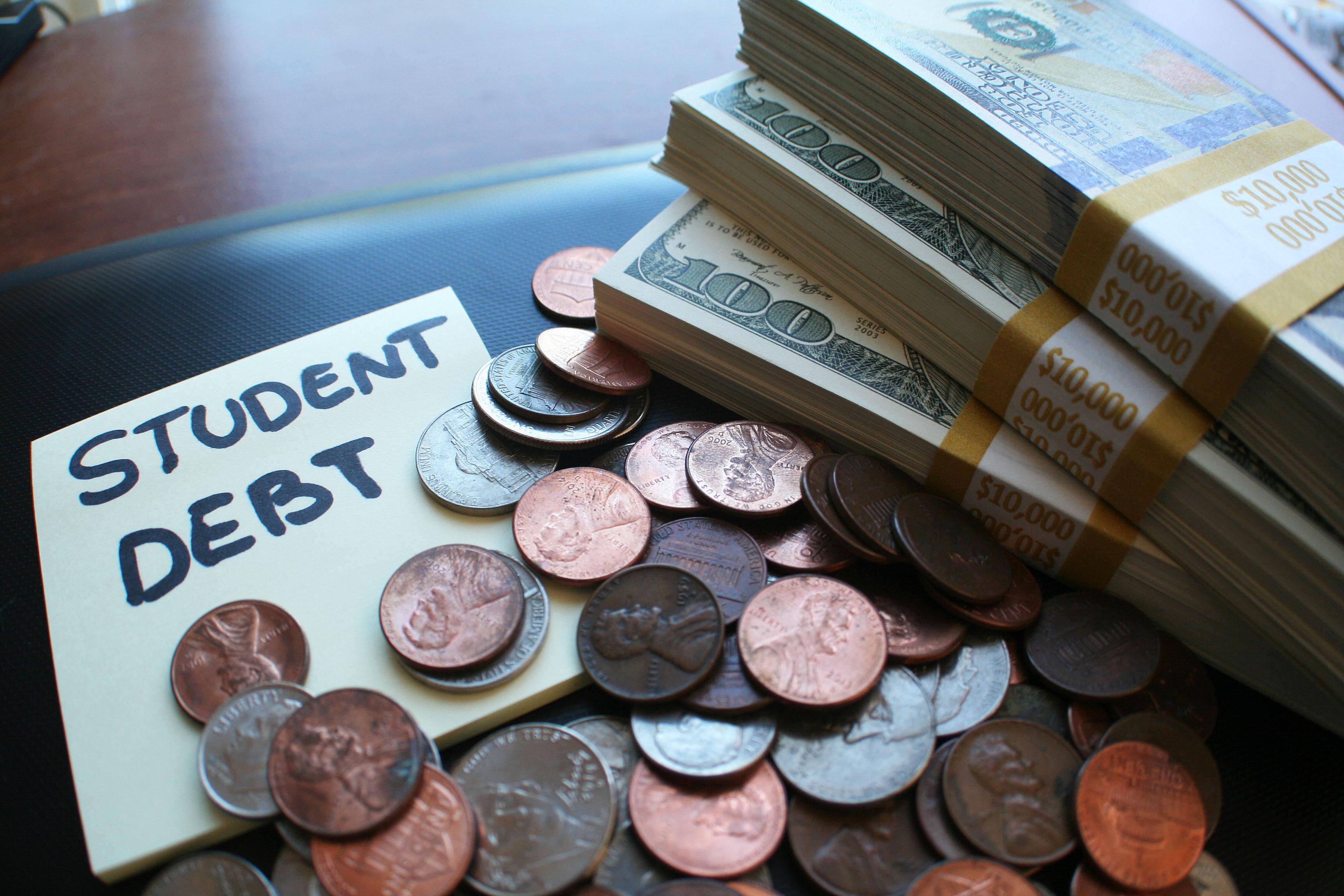 piles of cash representing student debt