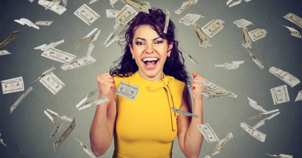Woman enjoying a sudden windfall of money